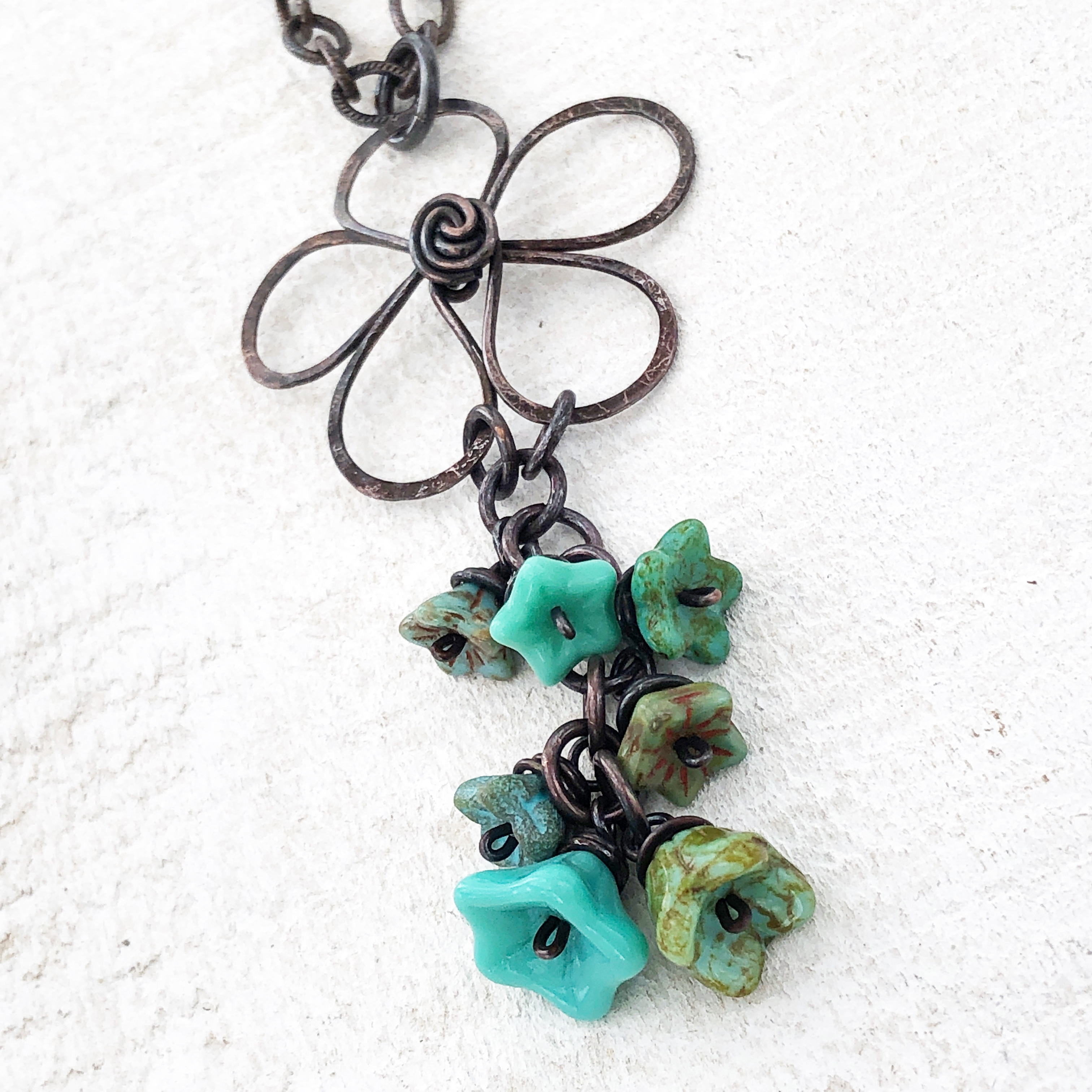 Copper wirework flower with handwrapped turquoise Czech glass beads